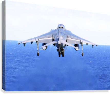 An AV-8B Harrier jet launches off the flight deck of USS Peleliu.  Canvas Print
