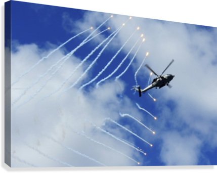 An HH-60H Sea Hawk helicopter releases countermeasure flares.  Canvas Print