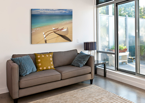 WHITE OUTRIGGER CANOE ON SHORELINE WITH SHADOW, CALM TURQUOISE WATER PACIFICSTOCK  Canvas Print