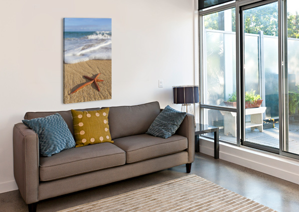 A RED LIVE FINGER STARFISH, ALSO KNOWN AS LINCKIA SEA STAR, FOUND ALONG A SANDY BEACH WITH WHITE OCEAN TIDE WASHING UP; HONOLULU, OAHU, HAWAII, UNITED STATES OF AMERICA PACIFICSTOCK  Canvas Print