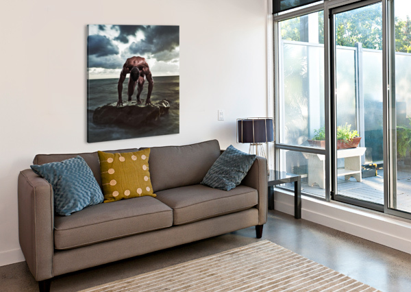 A MUSCULAR MAN IN THE STARTING POSITION ON A WET ROCK IN THE WATER;TARIFA CADIZ ANDALUSIA SPAIN PACIFICSTOCK  Canvas Print