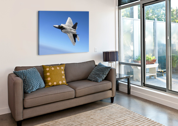 AN F-A-22 RAPTOR BANKS DURING A TRAINING SORTIE. STOCKTREKIMAGES  Canvas Print