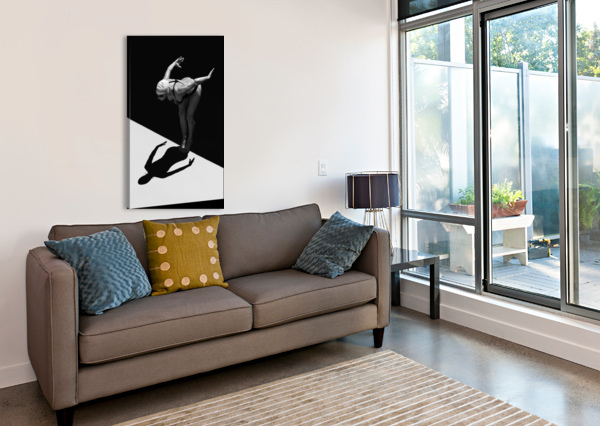 A WOMAN PREPARES TO JUMP BACKWARDS OFF THE EDGE OF A POOL INTO THE WATER; TARIFA, CADIZ, ANDALUSIA, SPAIN PACIFICSTOCK  Canvas Print