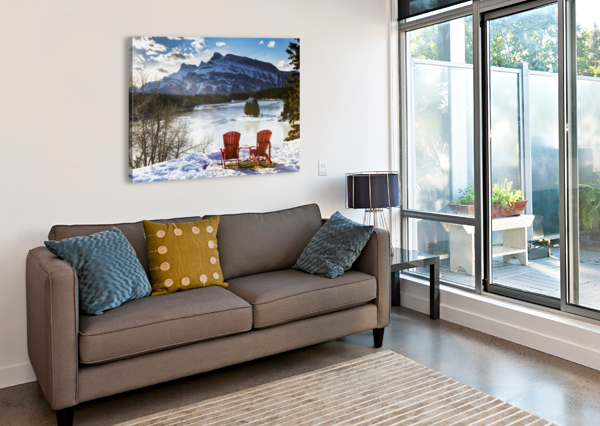 TWO RED CHAIRS ON SNOW COVERED RIDGE OVERLOOKING FROZEN LAKE WITH SNOW COVERED MOUNTAIN IN THE BACKGROUND WITH BLUE SKY AND CLOUDS; BANFF, ALBERTA, CANADA PACIFICSTOCK  Canvas Print