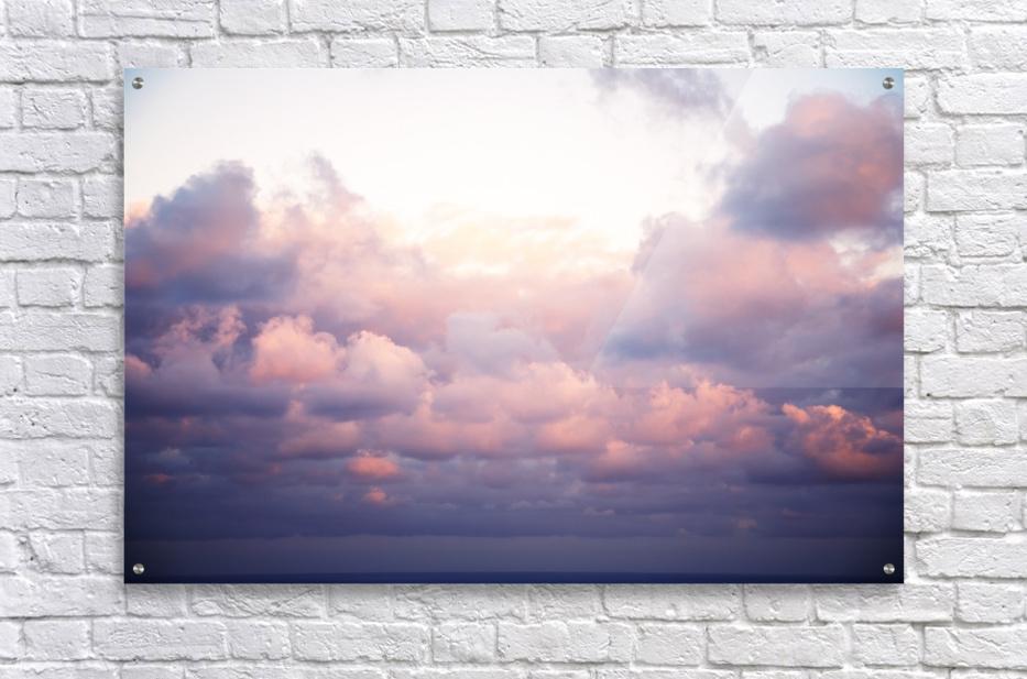 Cumulous pink clouds over horizon; Aina Haina, Oahu, Hawaii, United States of America  Acrylic Print