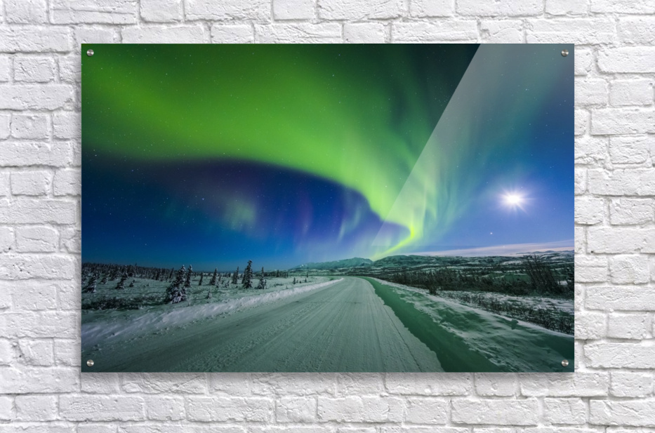 The moon and aurora shine in the night sky over a snow covered Richardson Highway south of Delta Junction; Alaska, United States of America  Acrylic Print