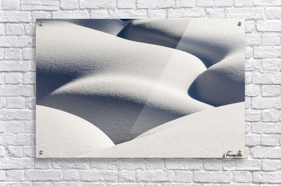 Artistic montage of snow contouring a creek bed with graphic designs of curving highlights and shadows; Lake Louise, Alberta, Canada  Acrylic Print