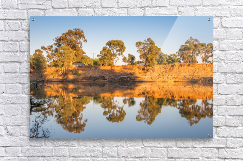 Tranquil river bank reflections at sunrise  Acrylic Print