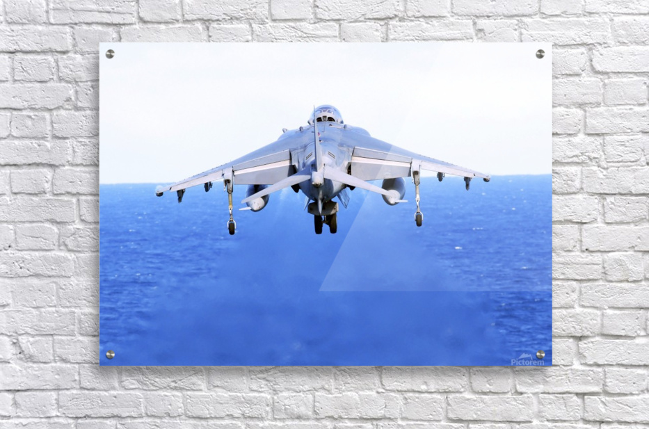An AV-8B Harrier jet launches off the flight deck of USS Peleliu.  Acrylic Print