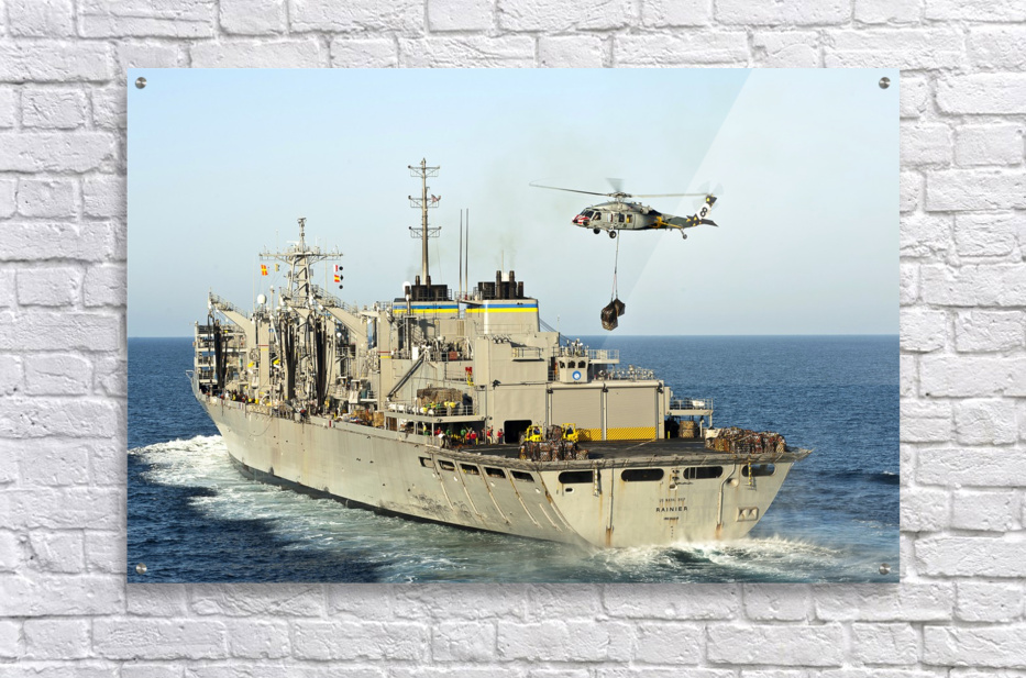 An MH-60S Knighthawk lifts cargo from the fast combat support ship USNS Rainier.  Acrylic Print