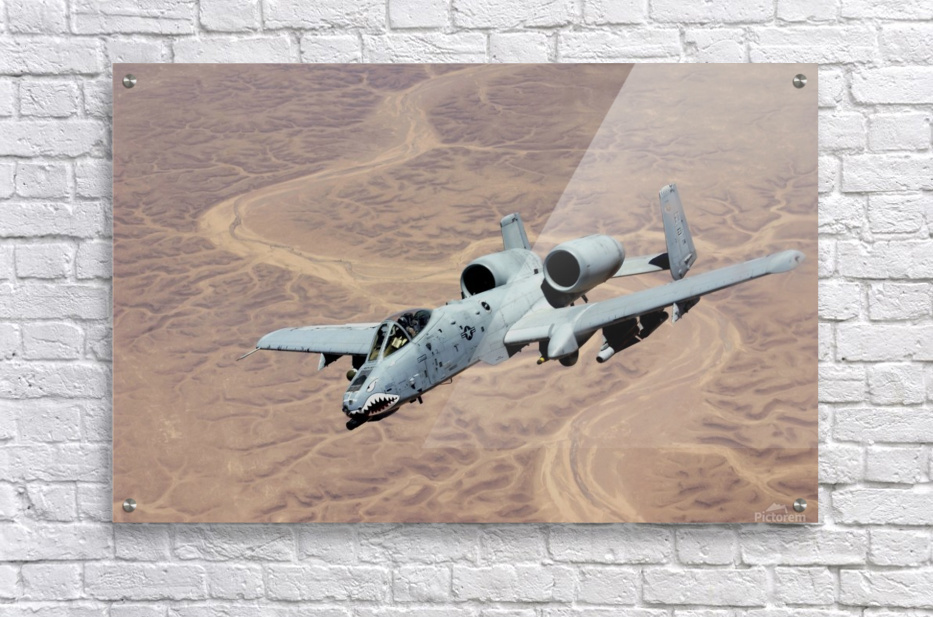 An A-10 Thunderbolt soars above the skies of Iraq.  Acrylic Print