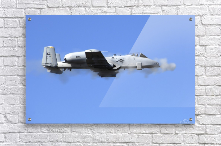 A pilot in an A-10 Thunderbolt II fires the planes 30-mm cannon.  Acrylic Print