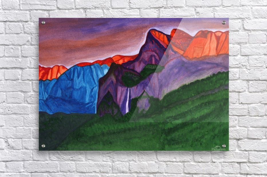 Snowy peaks of the mountains with a waterfall lit up by the orange dawn  Acrylic Print