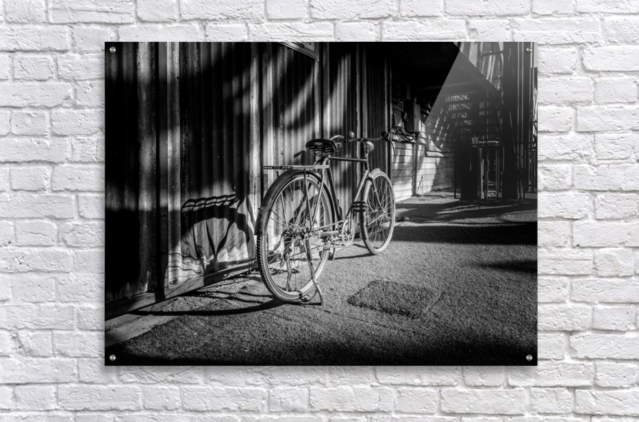 Bicycle parked against the building black and white  Acrylic Print