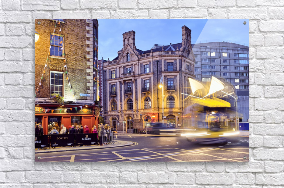 City street with people outside of pub at night Dublin Ireland  Acrylic Print