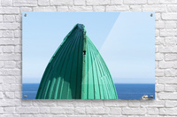 Close-up of  the bottom of the bow of a wooden boat painted green and the tranquil water and blue sky in the background; South Shields, Tyne and Wear, England  Acrylic Print