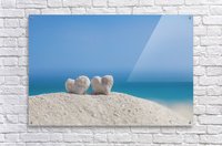 Two white heart shaped coral rocks placed together on sand at the beach; Honolulu, Oahu, Hawaii, United States of America  Acrylic Print