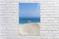 A lavender heart shaped sea glass in the sand at the beach; Honolulu, Oahu, Hawaii, United States of America  Acrylic Print