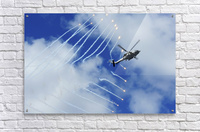 An HH-60H Sea Hawk helicopter releases countermeasure flares.  Acrylic Print