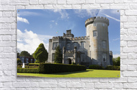 Stone castle with turret, manicured grass, gardens, fountain, blue sky and clouds; County Clare, Ireland  Acrylic Print