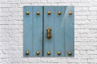 A Blue Door With Brass Decorative Knobs; Cusco, Peru  Acrylic Print
