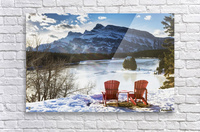 Two red chairs on snow covered ridge overlooking frozen lake with snow covered mountain in the background with blue sky and clouds; Banff, Alberta, Canada  Acrylic Print