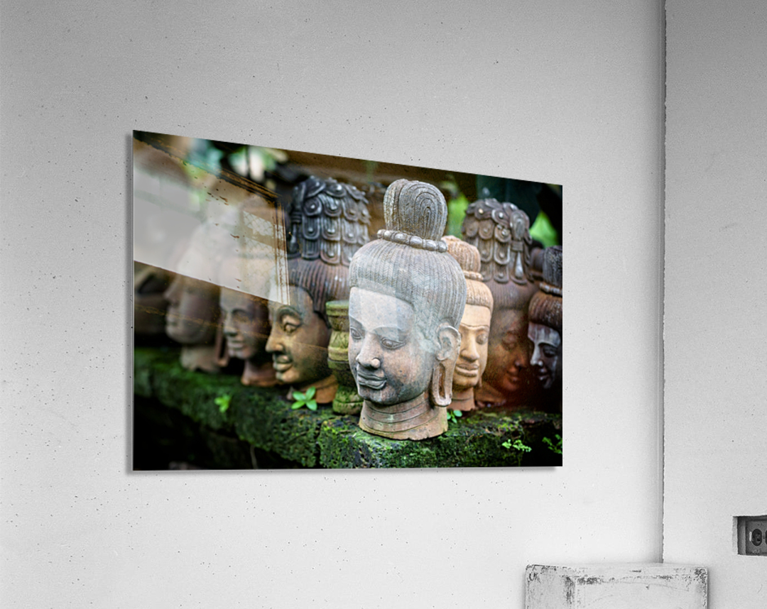 Heads of statues of Buddha are stacked in a terra-cotta factory; Chiang Mai, Thailand  Acrylic Print