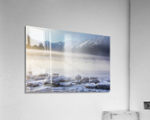 The sun shines through low altitude fog cast in warm light along Turnagain Arm and the Seward Highway, sea ice covering the ocean in the foreground, the Kenai Moutains revealed in the background, South-central Alaska; Alaska, United States of America  Acrylic Print