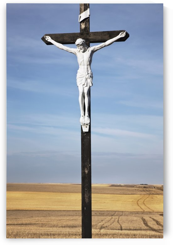 Crucifix and a farm field in the background;Saskatchewan canada by PacificStock