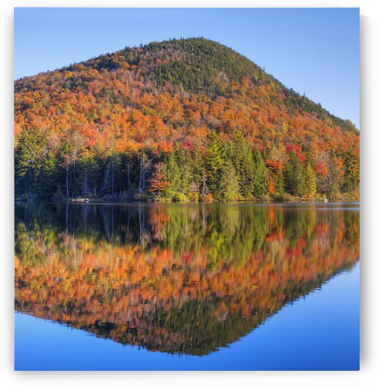 Mountain reflected in Sugarloaf pond in autumn; Quebec, Canada by PacificStock