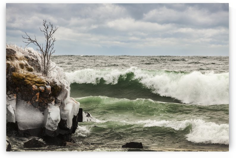 Waves of Lake Superior, ice and rocks along the shoreline; Thunder Bay, Ontario, Canada by PacificStock