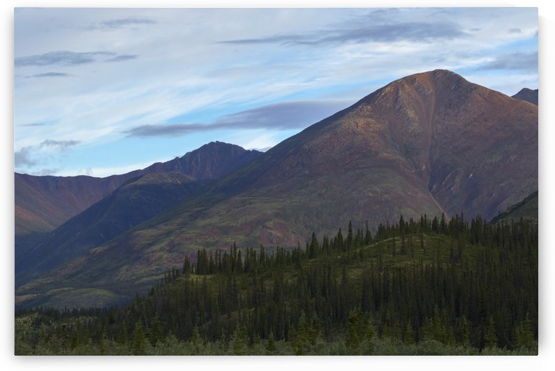 Late afternoon light shining on the mountains along the Wind River in the Peel Watershed; Yukon, Canada by PacificStock