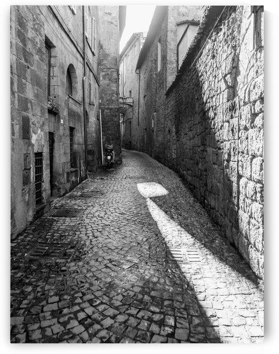 Narrow cobblestone alley between buildings; Orvieto, Umbria, Italy by PacificStock