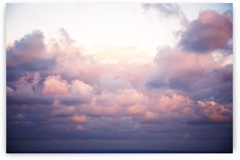 Cumulous pink clouds over horizon; Aina Haina, Oahu, Hawaii, United States of America by PacificStock