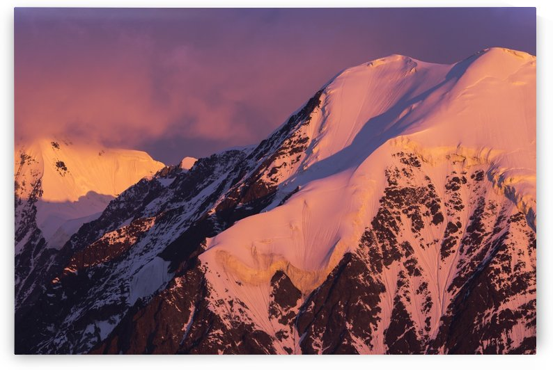 Morning alpenglow on an unnamed peak near McGinnis Glacier in the Alaska Range; Alaska, United States of America by PacificStock