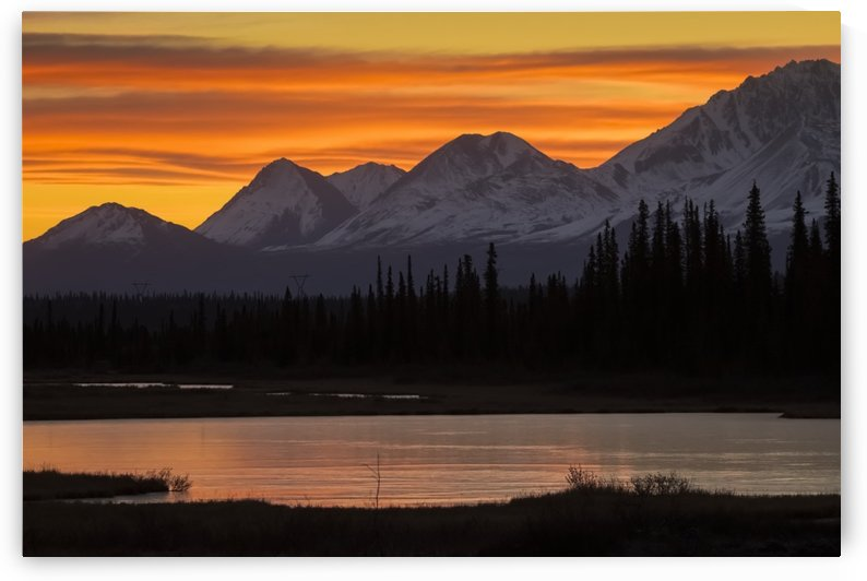 Sunrise over the pond and mountains along the Parks Highway in autumn, near Cantwell in interior Alaska; Alaska, United States of America by PacificStock