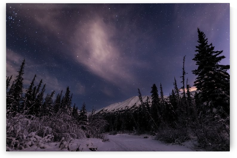 Night skies above Chugach Mountains and Eagle River Valley on winter solstice in South-central Alaska; Alaska, United States of America by PacificStock