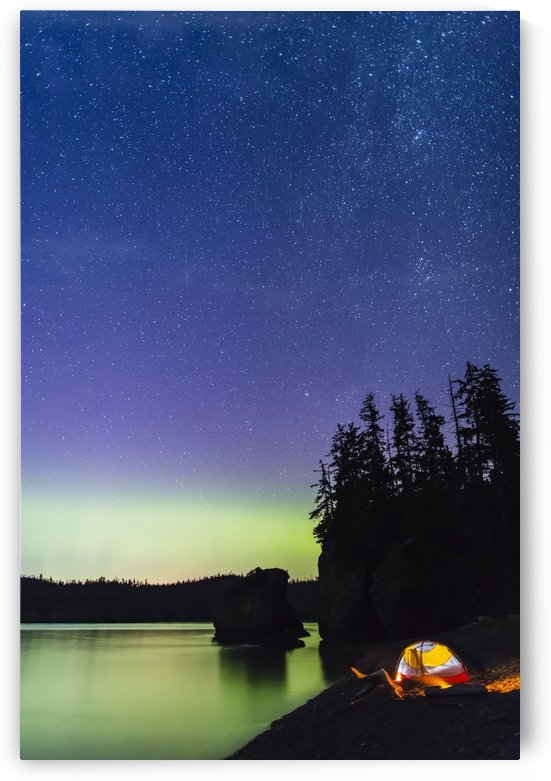 A glowing tent on a beach overlooks green Aurora Borealis reflected in the tranquil ocean water, Hesketh Island; Homer, Alaska, United States of America  by PacificStock