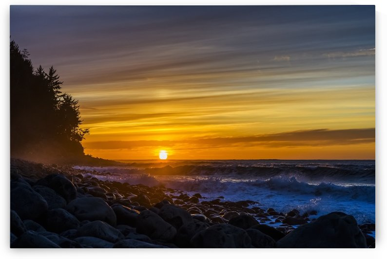 The sun sets over the ocean on the Oregon Coast; Seaside, Oregon, United States of America by PacificStock