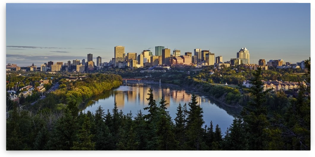 Skyline of downtown Edmonton reflected in the North Saskatchewan River under a blue sky; Edmonton, Alberta, Canada by PacificStock
