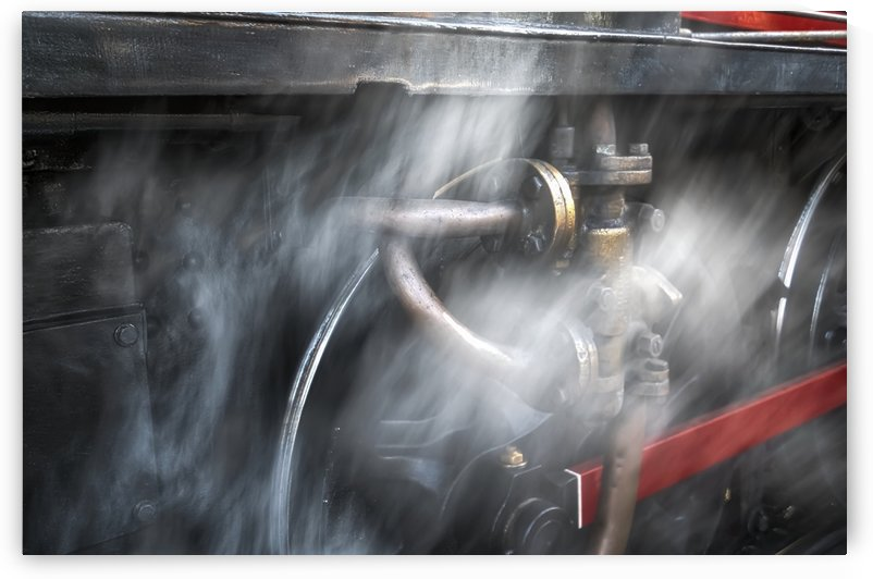 Dust blurs the wheels of a railroad car; North Yorkshire, England by PacificStock