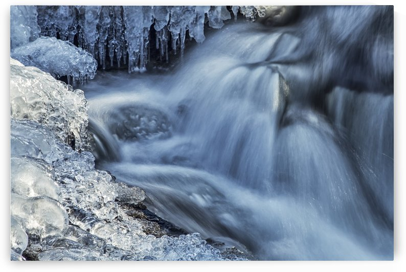 Icicles and blue shadowed cascades on a small waterfall; Enfield, Nova Scotia, Canada by PacificStock
