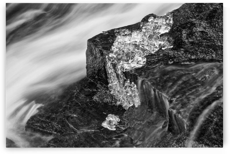 A brook flowing out of Hobsons Lake with ice on the wet rock, Birch Cove Lakes Wilderness; Bedford, Nova Scotia, Canada by PacificStock