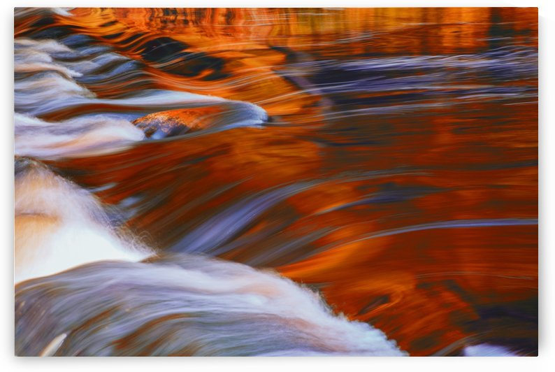 Mersey River reflections in autumn transformed into red via digital filter for a more interpretive effect at Kejimkujik National Park; Nova Scotia, Canada by PacificStock