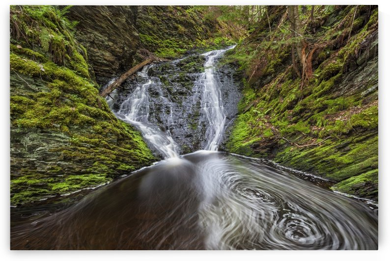 Waterfall and pool in a mossy forest ravine in springtime along Old Sanford Brook near West Gore; Nova Scotia, Canada by PacificStock