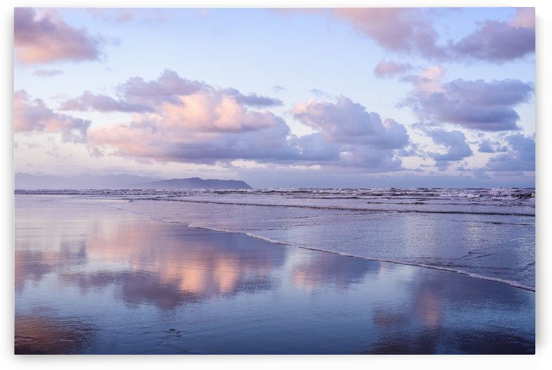 Clouds reflect on an Oregon beach at sunrise; Hammond, Oregon, United States of America by PacificStock