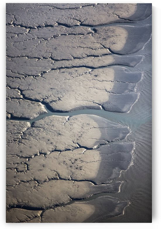 Aerial view of patterns made by water draining over the Silt Mud Flats along Cook Inlet, South-central Alaska; Alaska, United States of America by PacificStock