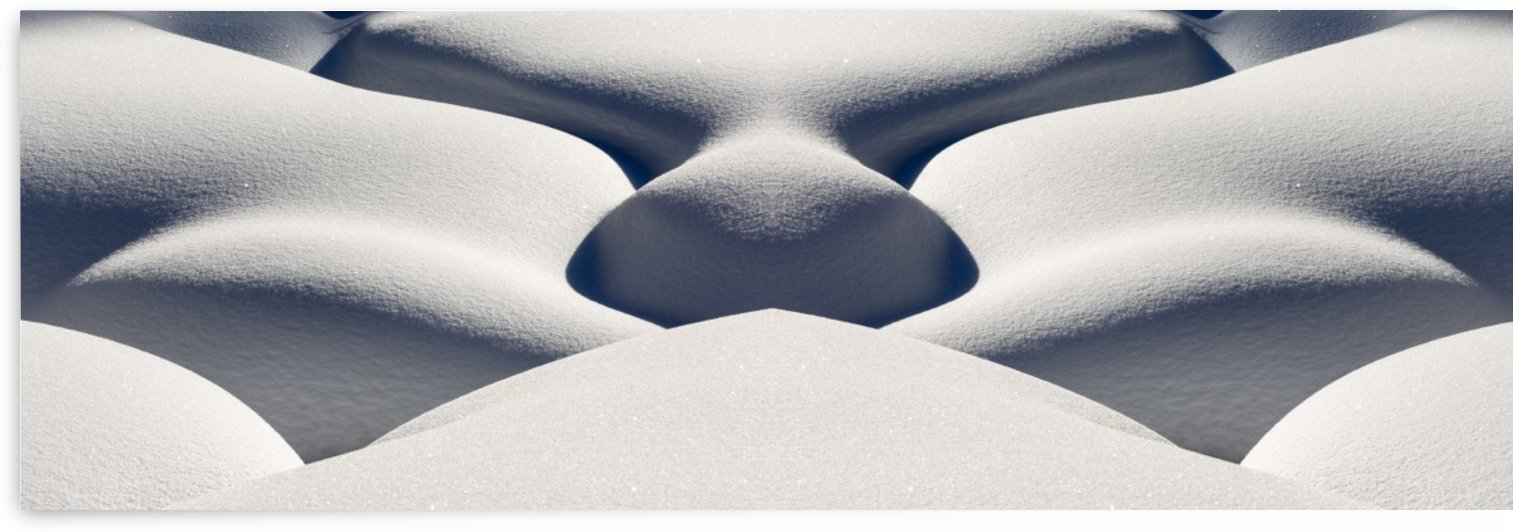 Artistic montage of snow contouring a creek bed with graphic designs of curving highlights and shadows; Lake Louise, Alberta, Canada by PacificStock