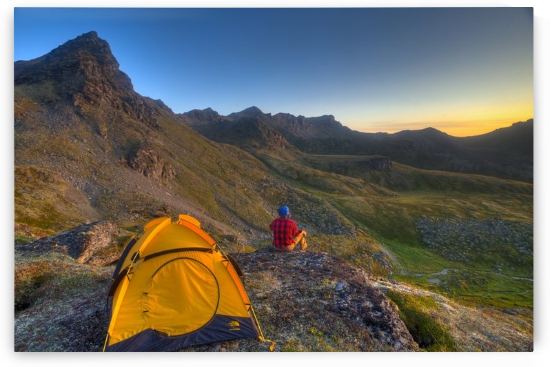 A Man Sitting On A Rock Next To His Tent While Camping Near Hatcher Pass In The Talkeetna Mountains With Bald Ridge In The Background, Southcentral Alaska, Summer by PacificStock