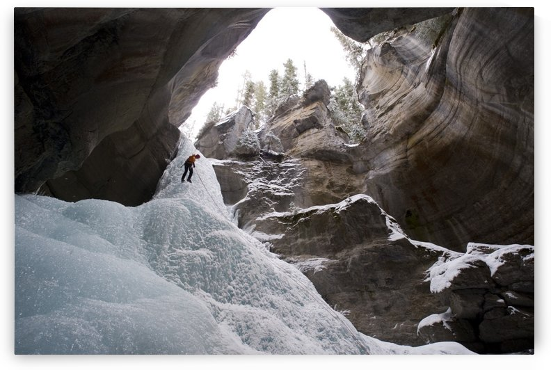 Female Ice Climber Rappels Into The Head Of Maligne Canyon In Jasper National Park, Alberta, Canada by PacificStock